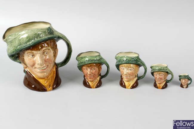 A large group of Royal Doulton character jugs.