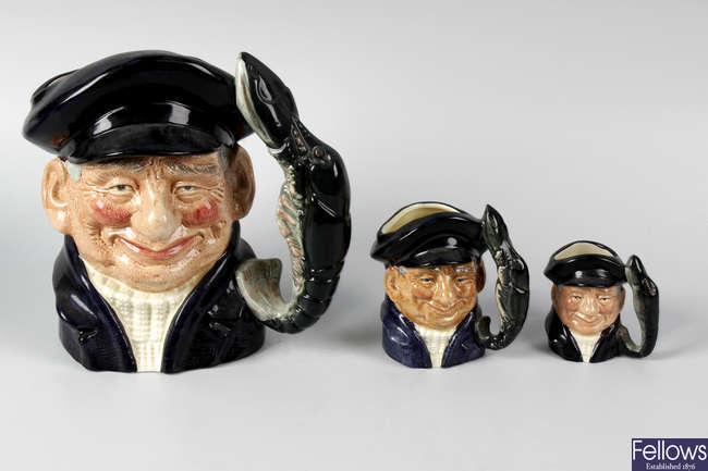 A group of Royal Doulton character jugs.
