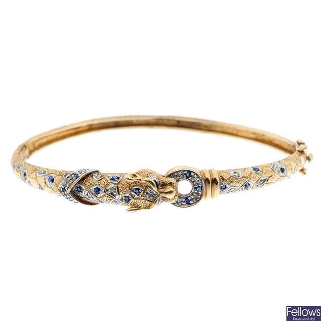 A sapphire and diamond leopard hinged bangle.