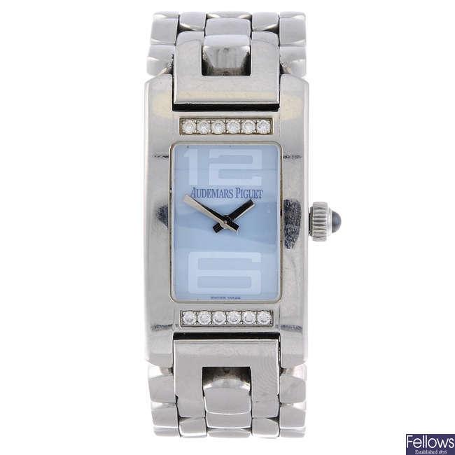 AUDEMARS PIGUET - a lady's factory diamond set stainless steel Promesse bracelet watch.