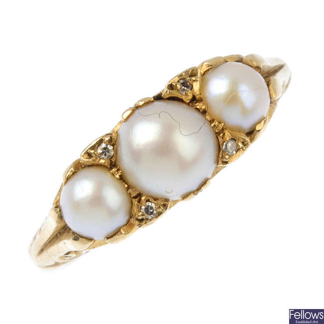 A split pearl and diamond three-stone ring.