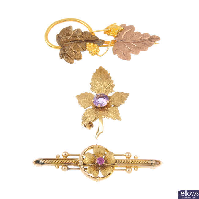 Three gold and gem-set brooches.