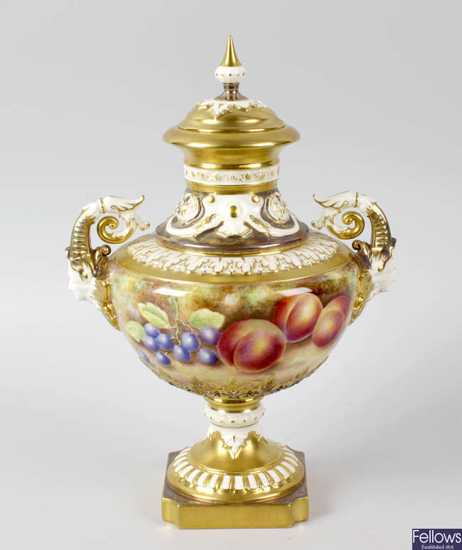 A good Royal Worcester porcelain fruit-painted vase and cover by Leaman