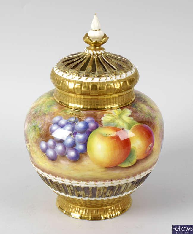 A large Royal Worcester porcelain fruit-painted pot pourri vase and cover by Leaman