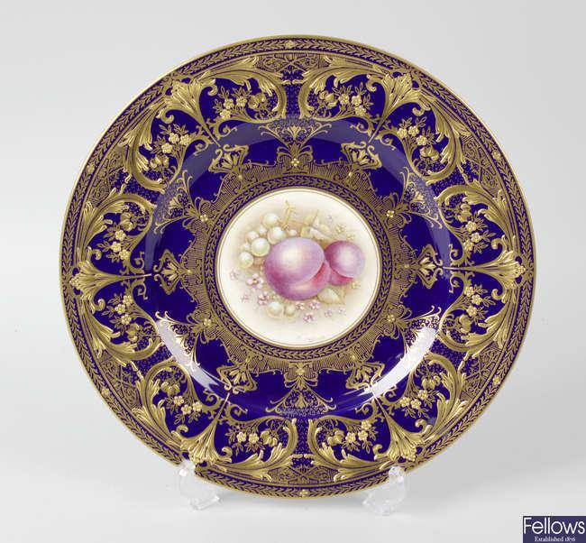 A Royal Worcester porcelain fruit-painted plate, blue border (plum)