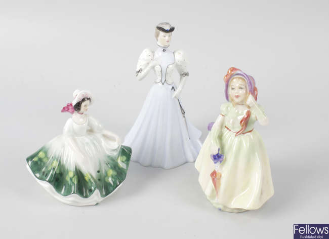 A group of fourteen small Royal Doulton figures