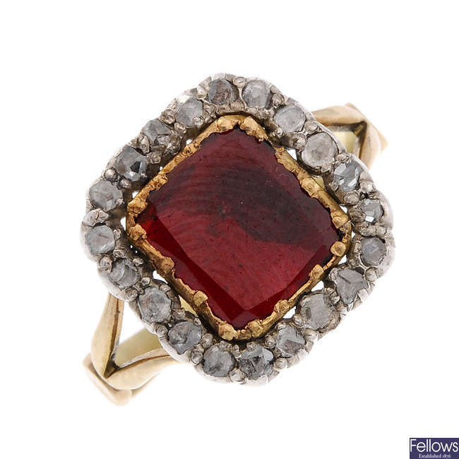 An early 19th century gold, foil back garnet and diamond cluster ring.