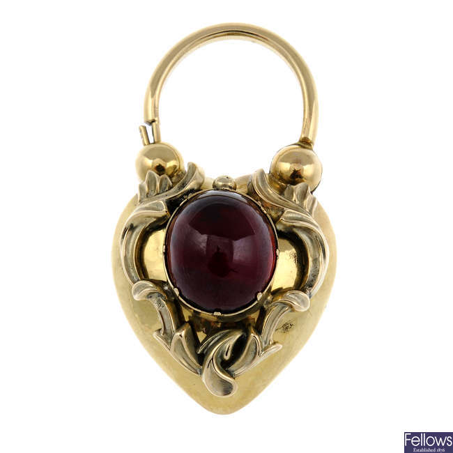 A late Victorian gold and garnet cabochon memorial clasp.