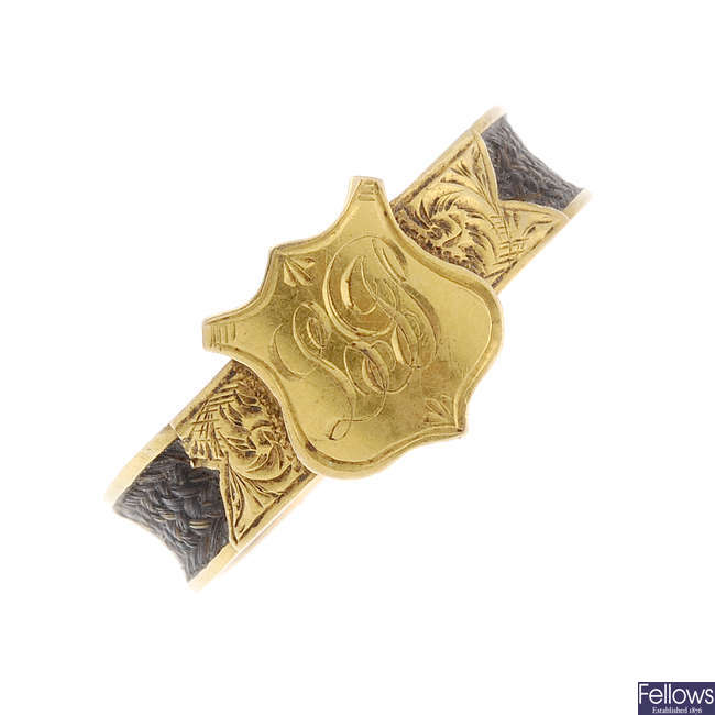An early 20th century 18ct gold and hair memorial monogram ring.
