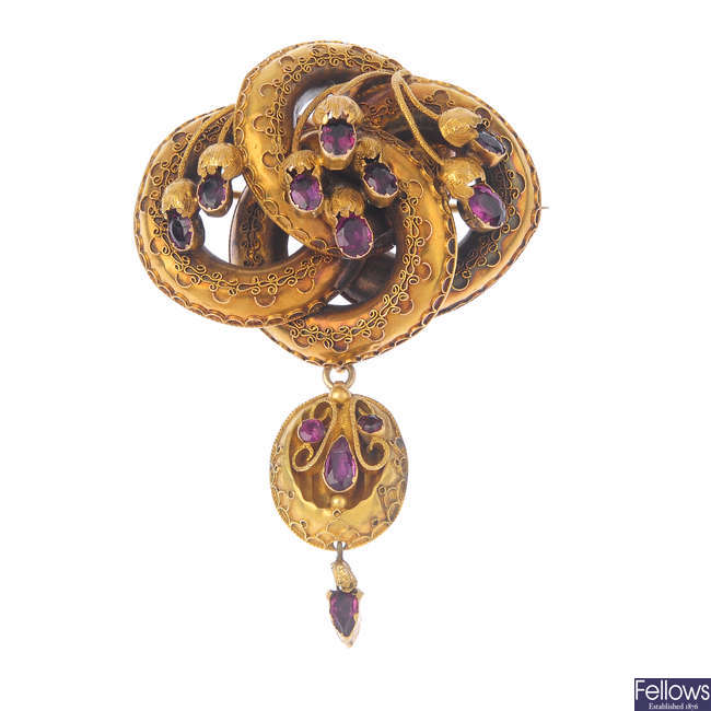 A mid Victorian gold garnet brooch.