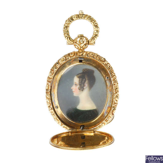 An early Victorian 9ct gold hand painted portrait memorial pendant.