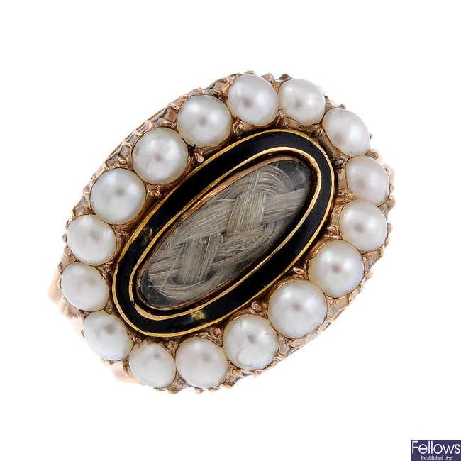 A late Georgian 9ct gold split pearl and enamel memorial ring.