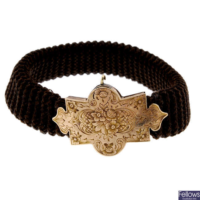 A mid Victorian memorial hair bracelet with 15ct gold clasp.