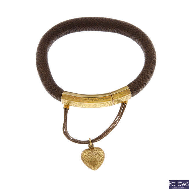 An early to mid Victorian memorial hair bangle with 18ct gold clasp.