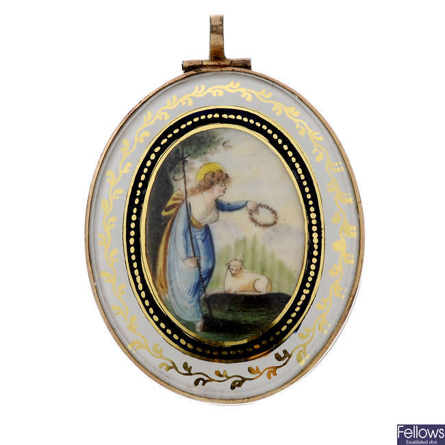 A mid to late Victorian hand painted and enamel hinged pendant.