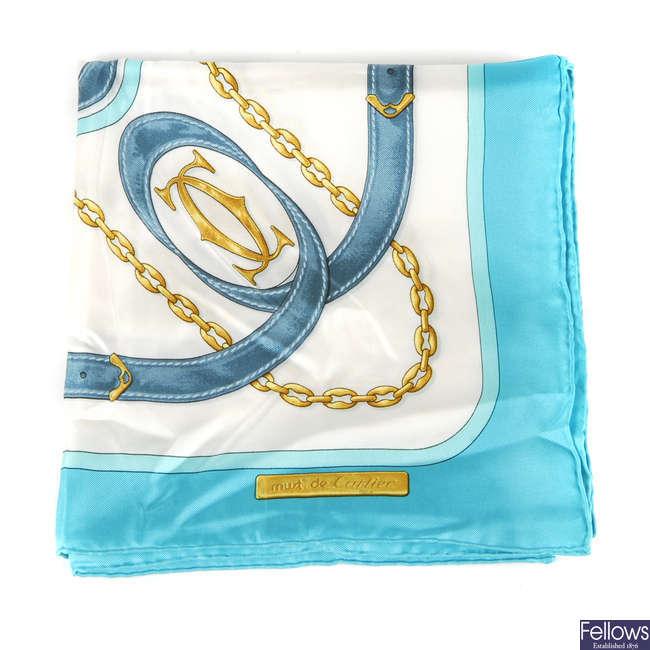 CARTIER - a 1980s Must De Cartier silk scarf.