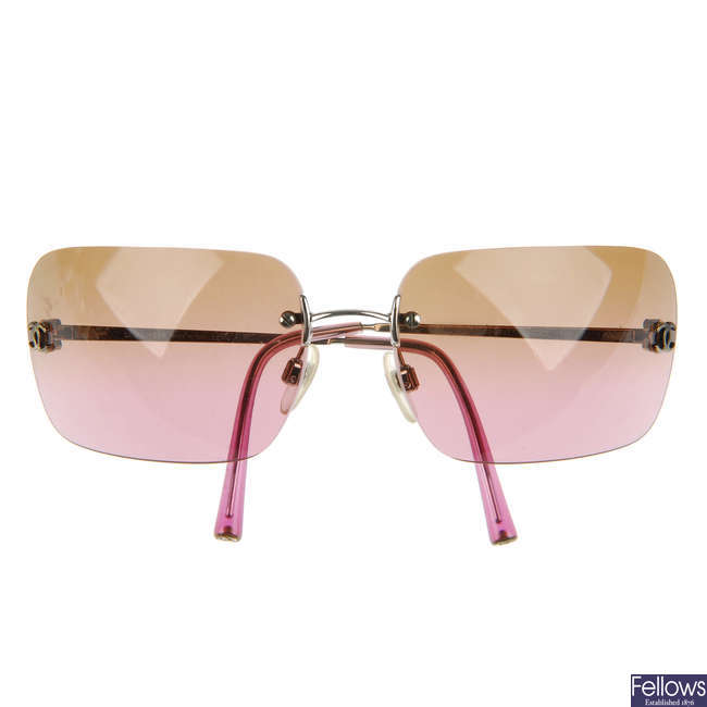 CHANEL - a pair of rimless sunglasses
