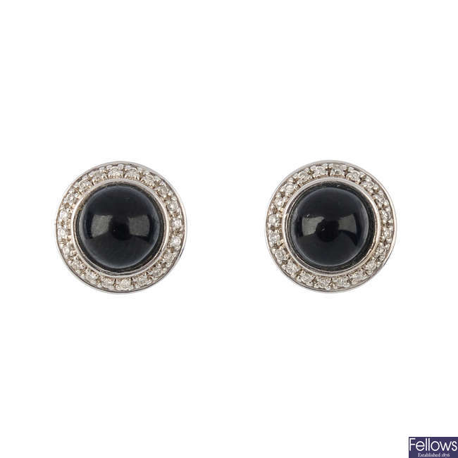 A pair of 18ct gold onyx and diamond earrings.