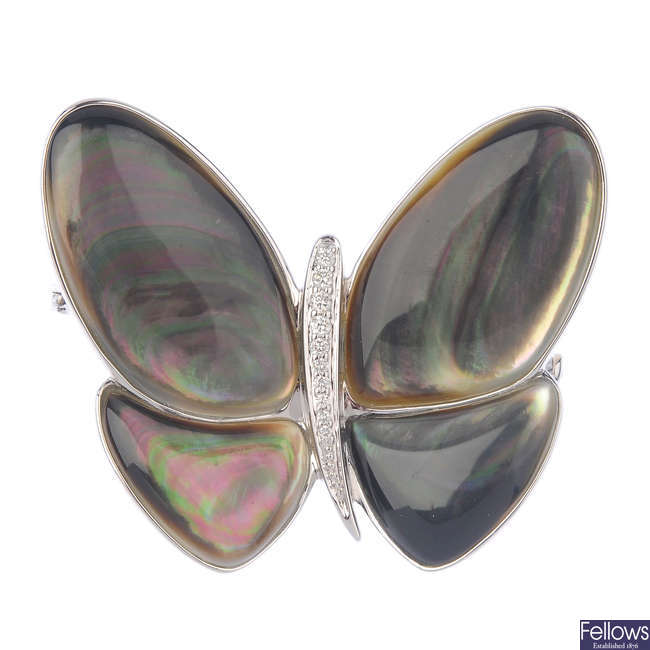 A mother-of-pearl and diamond butterfly pendant.