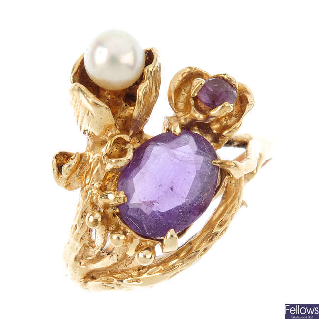 An amethyst and cultured pearl dress ring.