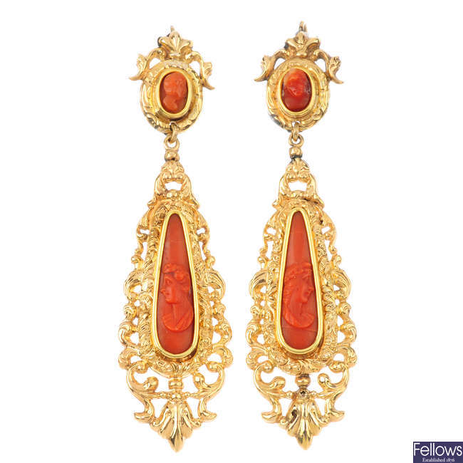 A pair of coral cameo earrings.