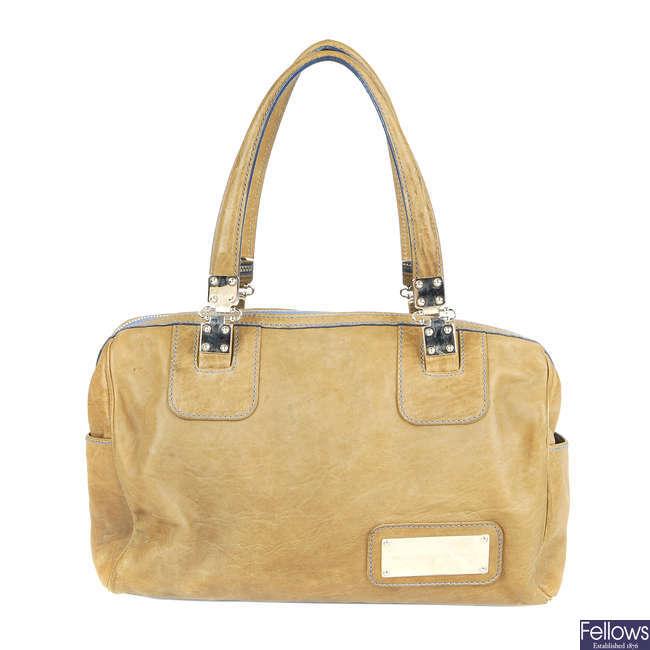 BALENCIAGA - a small leather handbag.