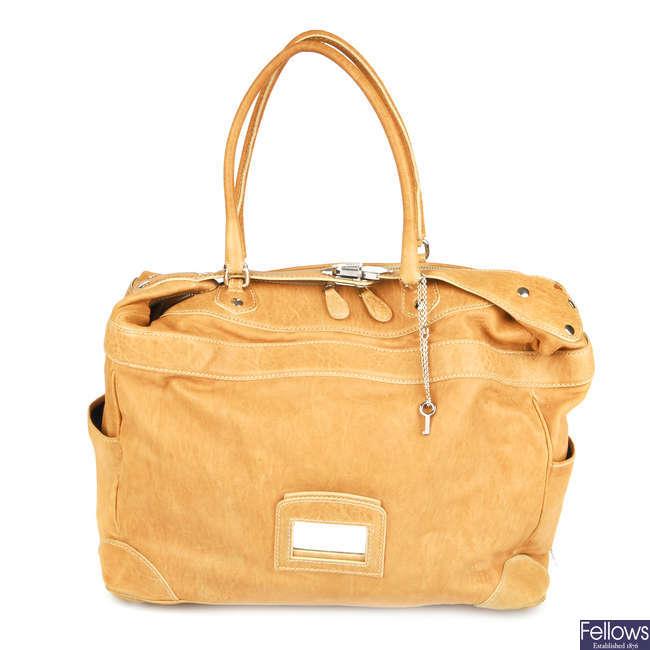BALENCIAGA - a leather handbag.