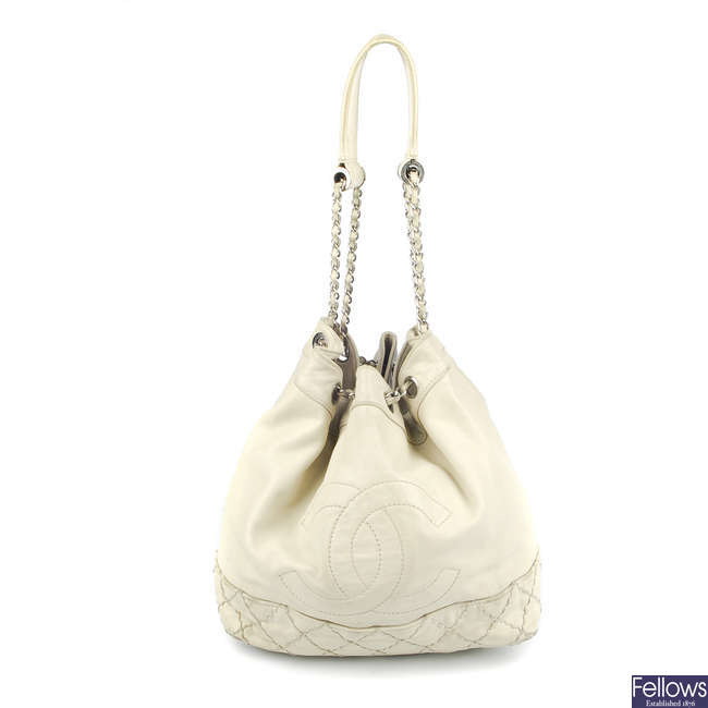 CHANEL - a cream leather drawstring bucket handbag.