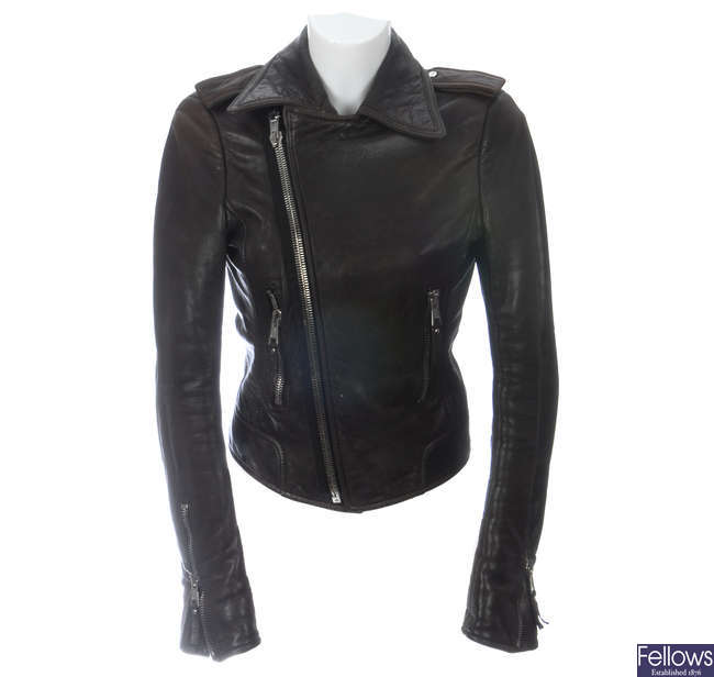 BALENCIAGA - a brown leather biker jacket.
