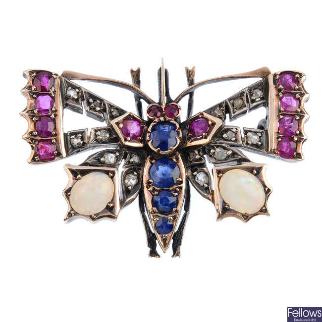 A late Victorian diamond and gem-set butterfly brooch.
