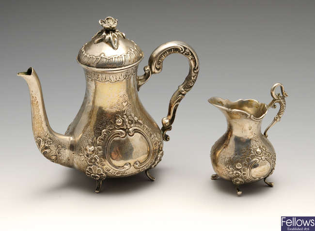 A German silver coffee pot and cream jug.
