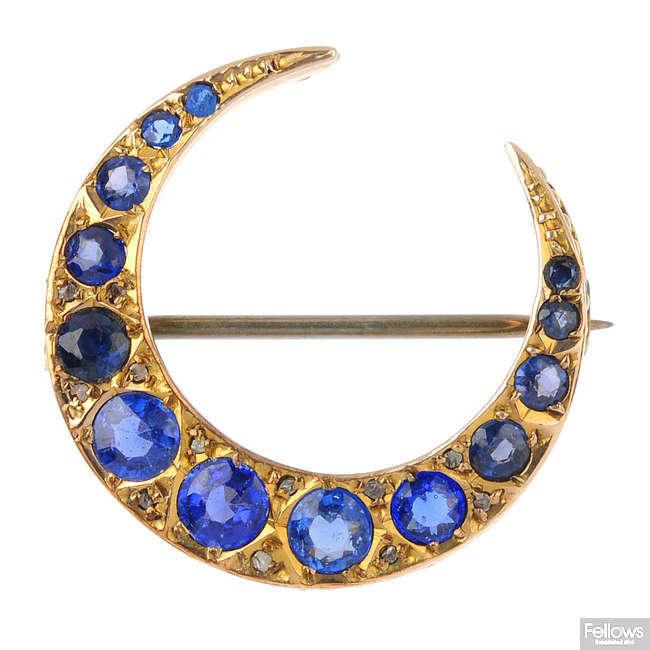 A 9ct gold gem-set crescent brooch.