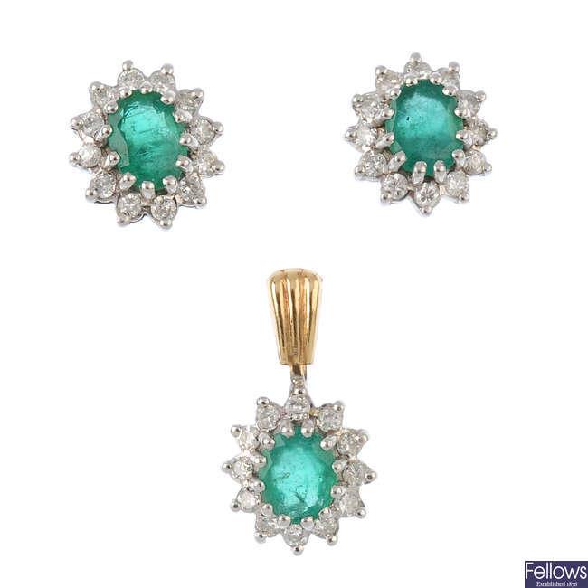 A set of emerald and diamond jewellery.