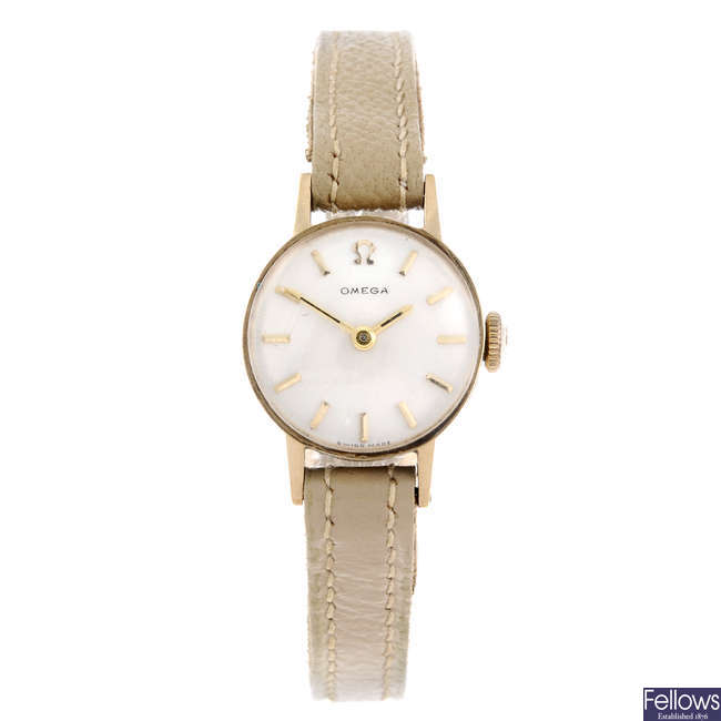 OMEGA - a lady's 9ct yellow gold wrist watch together with two watch heads.