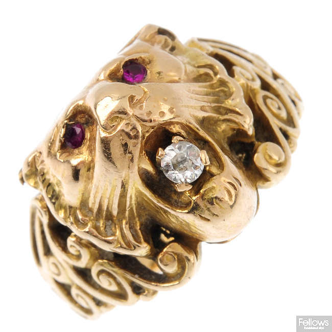 A late Victorian gold ruby and diamond lion head ring.
