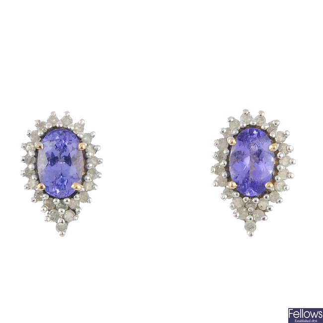 A pair of diamond and tanzanite cluster earrings.