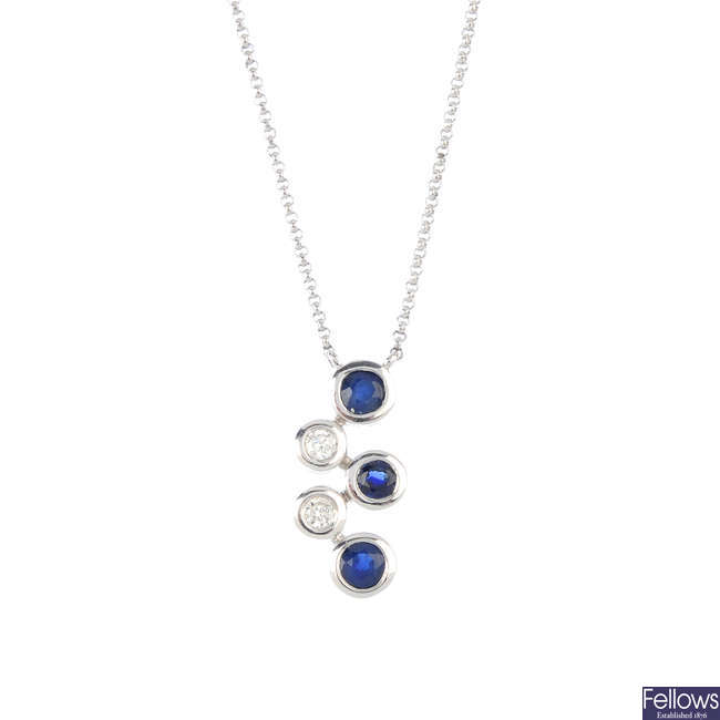 An 18ct gold sapphire and diamond pendant, on chain.