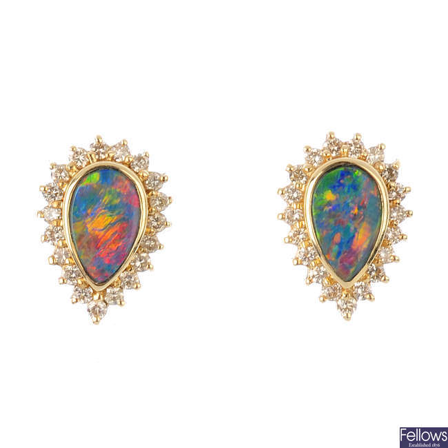 A pair of opal doublet and diamond cluster earrings.
