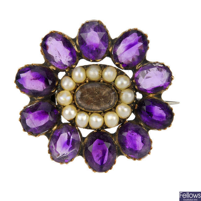 An early Victorian amethyst and split pearl memorial brooch.