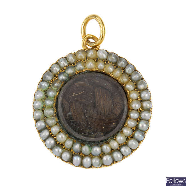 A mid Victorian gold and split pearl memorial pendant.