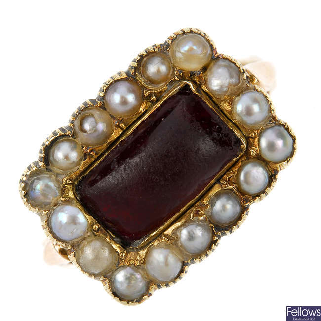 A late Georgian red paste and split pearl ring.