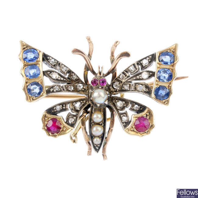 A late Victorian silver and gold gem-set butterfly brooch.