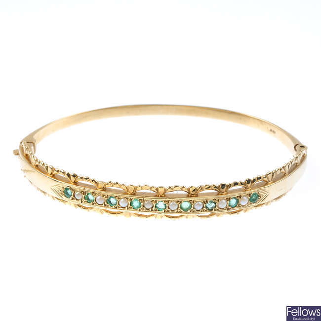 An emerald and split pearl hinged bangle.