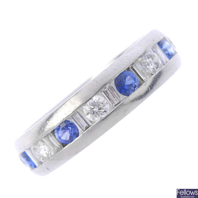A sapphire and diamond half eternity ring.