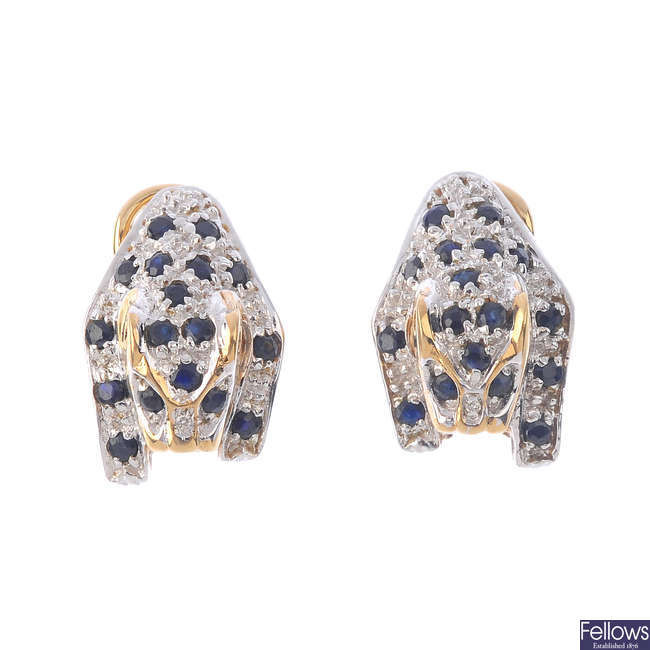 A pair of 9ct gold sapphire and diamond leopard earrings.
