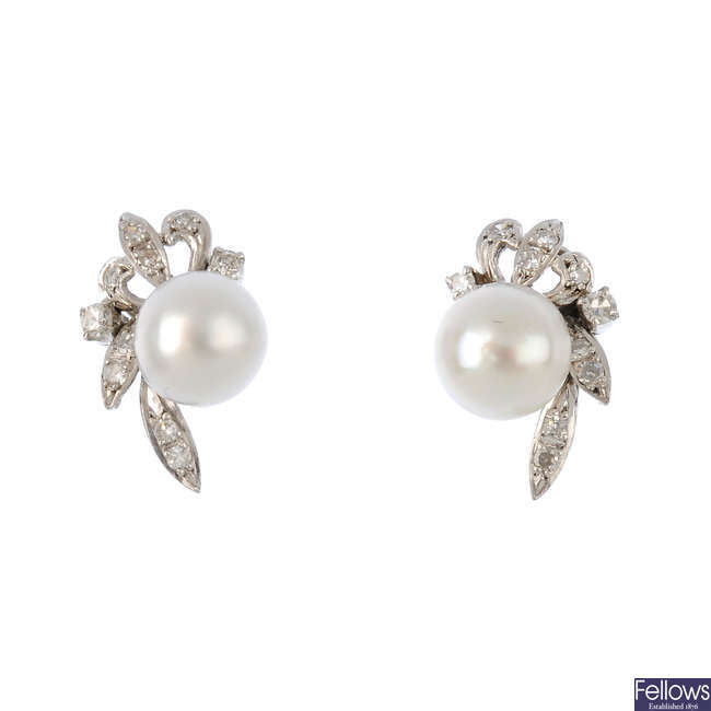 A pair of diamond and pearl earrings.