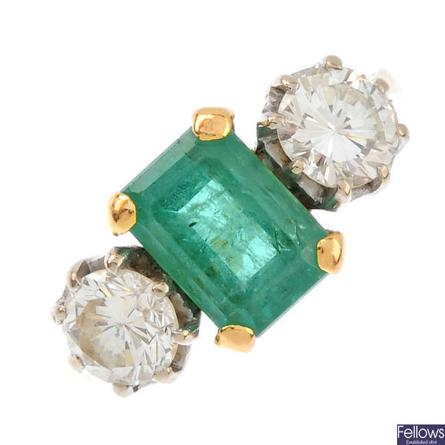 A mid 20th century 18ct gold, emerald and diamond three-stone ring.