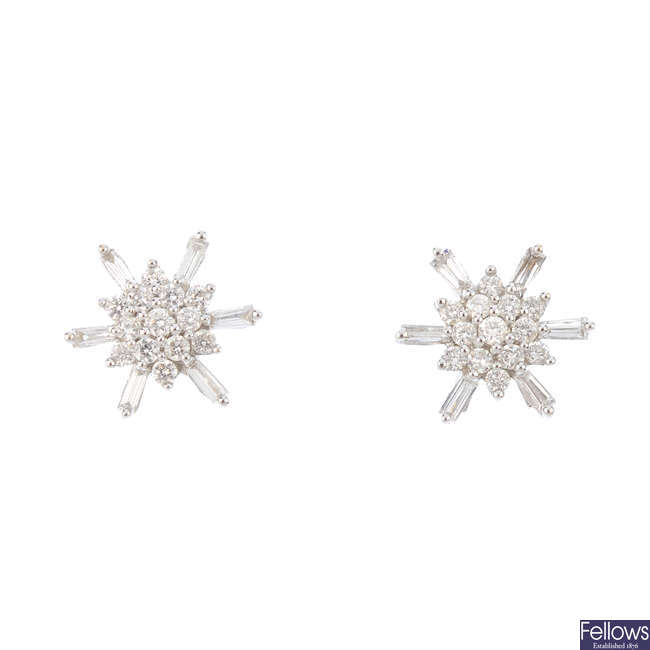 A pair of diamond cluster stud earrings.