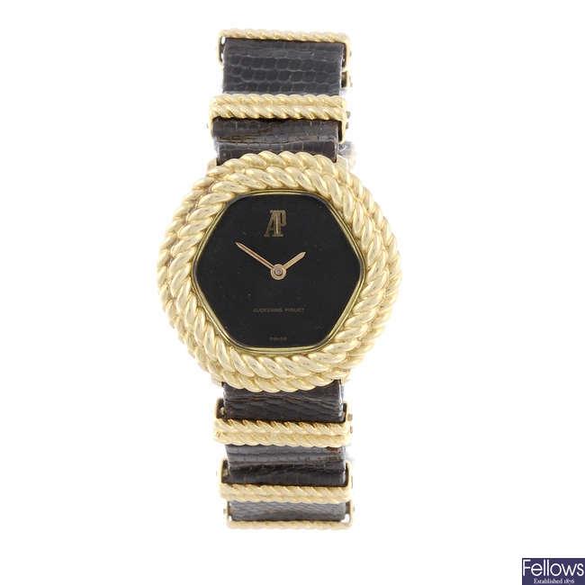 AUDEMARS PIGUET - a lady's yellow metal wrist watch.