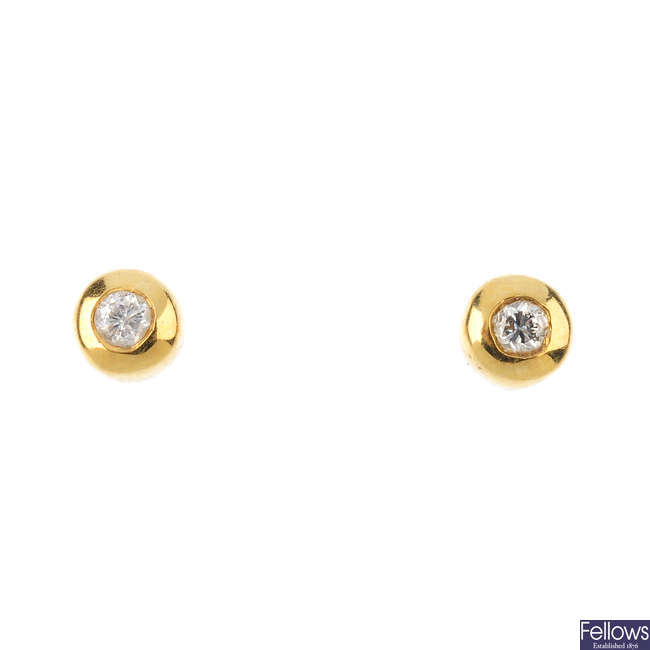 Two single 18ct gold diamond single-stone ear studs.